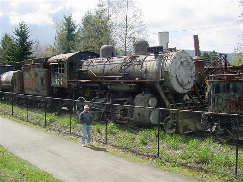 Alan standing by an old engine on display