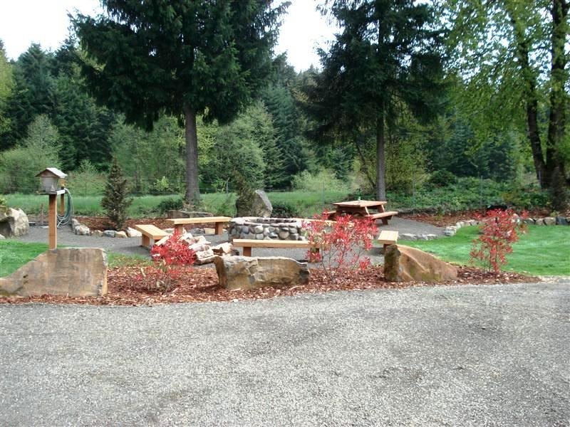 deluxe site with private fire pit and landscaping